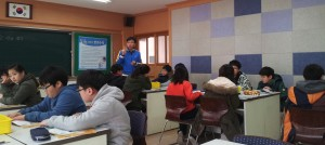 Students work on a lab in a science class at an elementary school in Gwangju.