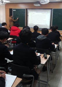 A teacher conducts an English grammar lesson to students at a high school in Daejeon.